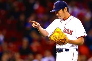 Koji Uehara has signed on with the defending World Series champions. (Jared Wickerham/Getty Images)