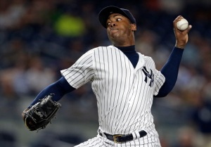 Aroldis Chapman is back in the Bronx on a five-year, $86 million contract. (Adam Hunger/USA TODAY Sports)